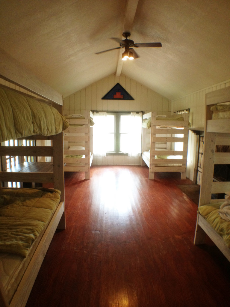 Beds inside the West House which has a private, screened in porch area for relaxing without the bugs.